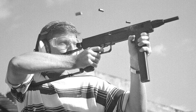 The author's son firing an experimental short-barreled 9mm INA 953