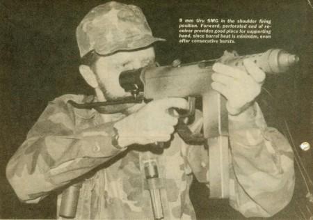 Author firing an Uru SMG