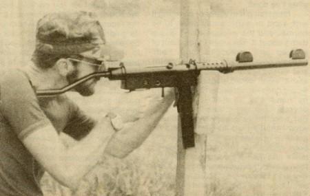 Author firing a suppressed Uru SMG