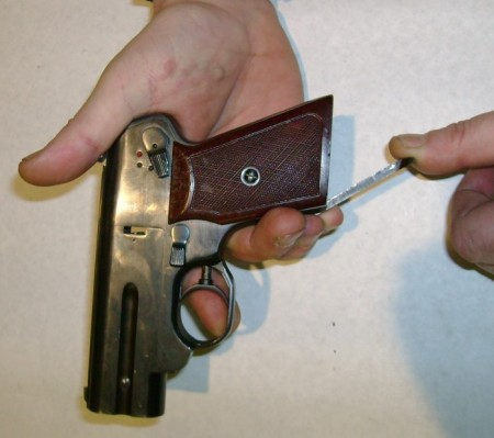 S4M pistol, cocking the internal hammers by pulling down the cocking lever