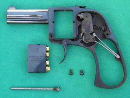 Bar pistol with lockwork exposed