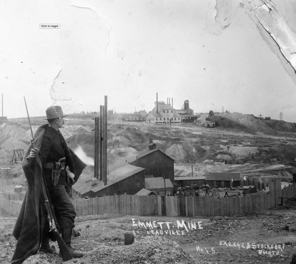 Man standing watch at the Emmett Mine in Leadville Colorado during labor disputes